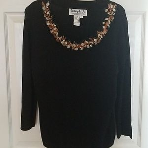 Pretty black sweater with beaded detailing